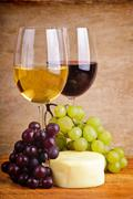 still life with grapes, cheese and wine - stock photo