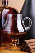 brandy and cigarillos - stock photo