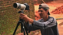 Man directs a lens at sharpness before video shooting Stock Footage
