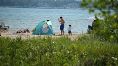 CAMPERS ON BEACH - stock footage