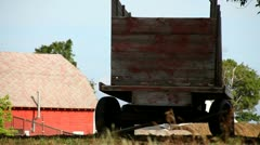 FARM - OLD FARM WAGON IN FOREGROUND - DOOR COUNTY, WISCONSIN Stock Footage