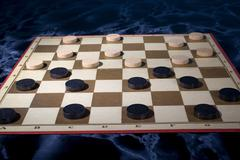 draughts game play freetime gambler player time - stock photo