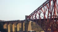 Stock Video Footage of Forth Bridge - wide pan with 2 trains
