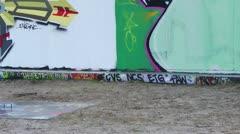 Graffiti wall and artist Stock Footage