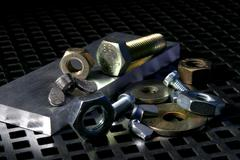 Design technology metal nut screw bolts nuts Stock Photos
