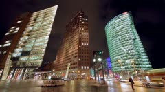 Time lapse night shot of Potsdamer Platz in Berlin with office skyscrapers Stock Footage