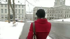 Scenes from Quebec City - girl walks through old square in Old Quebec Stock Footage