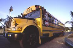 School bus yellow schoolbus in cuba traffic Stock Photos