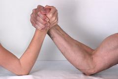 advantage fight uneven pitched arm wrestling - stock photo