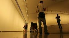 Admiring Anish Kapoor art (4) Stock Footage