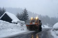 Winter road safety snowplough snowfall snow Stock Photos