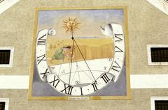 sun time past dial clock pouring box in essling - stock photo