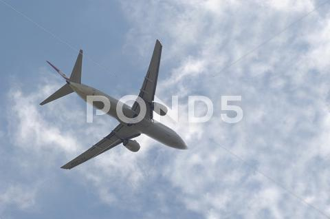 Stock photo of aircraft holiday travel airplane in sky aviation
