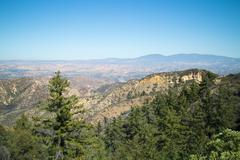 wide angle view overlooking trees and valley - stock photo