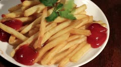 Stock Video Footage of man's hand takes French fries from a plate. Time lapse