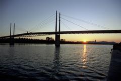 Water sunset pedestrian bridge over neue donau Stock Photos