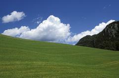 cloud meadow area cut landscape in mountains sky - stock photo