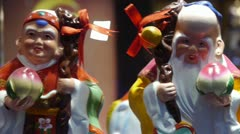 china myth character pottery artwork in store cupboard. - stock footage