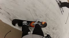 Strapping on the snowboard POV Stock Footage