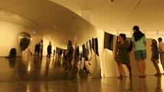 Admiring Anish Kapoor art (3) Stock Footage