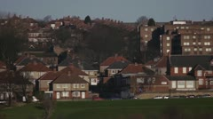 Houses with a church and traffic - stock footage