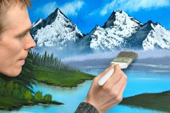 artist creating a landscape painting - stock photo