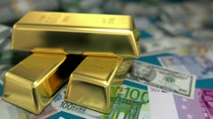 Gold bars and money on a table Stock Footage