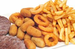 Tray with fattening food, such as burgers, croquettes, calamares and french f Stock Photos
