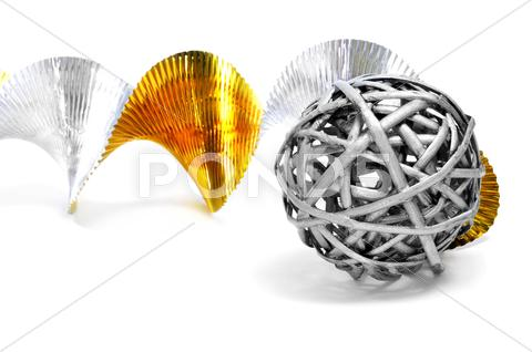 Stock photo of silver ball and golden and silver garland