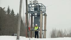 Electrician  near the transformer disconnector Stock Footage