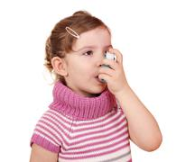Little girl with asthma inhaler Stock Photos