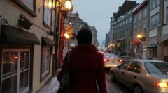 Scenes from Quebec City - girl walks down Old Quebec street slow motion Stock Footage