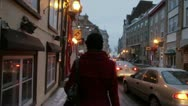 Stock Video Footage of Scenes from Quebec City - girl walks down Old Quebec street slow motion