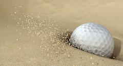 Golf ball in action hitting bunker sand Stock Illustration