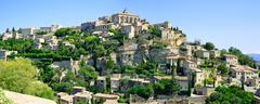 Gordes medieval village on rock hill panorama. luberon, provence, france. Stock Photos