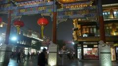 Timelapse crowd walk in China Beijing night market,memorial arch & lantern. Stock Footage