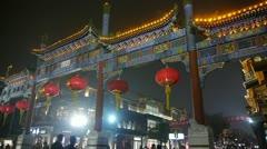 Crowd walk on Chinatown,China Beijing night market,memorial arch & lantern. Stock Footage