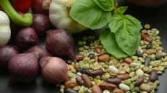 Background of assorted vegetables and dry beans Stock Footage