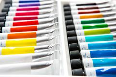 Colorful acrylic paints in tubes Stock Photos