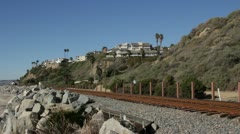 Passenger Train in California coastal landscape Stock Footage