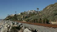 Stock Video Footage of Passenger Train in California coastal landscape