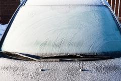 Frost on a completely covered car windscreen Stock Photos