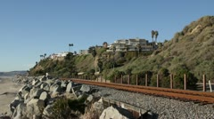 Passenger Train on California coastline Stock Footage