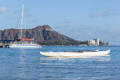Boat docked by diamond head waikiki hawaii Stock Photos