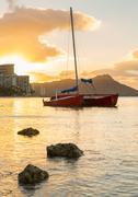 sunrise over diamond head from waikiki hawaii - stock photo