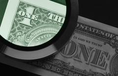 Stock Photo of dollar and magnifier