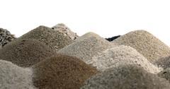 Various brown toned sand piles together Stock Photos