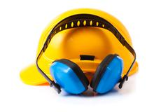 plastic safety helmet and hearing protection.  isolated - stock photo