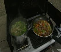Food cooking on a camp stove Stock Footage