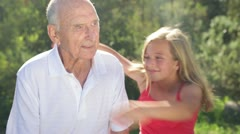 Granddaughter Hugs Grandfather Stock Footage
